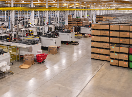 Tessy plant floor with machines boxes